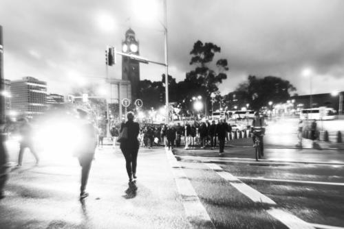 Black and white photograph of pedesterian crossing late evening central Sydney.