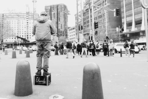 Eternity. Black and white picture of preacher standing on black box with the word 'Eternity'. Sydney central.