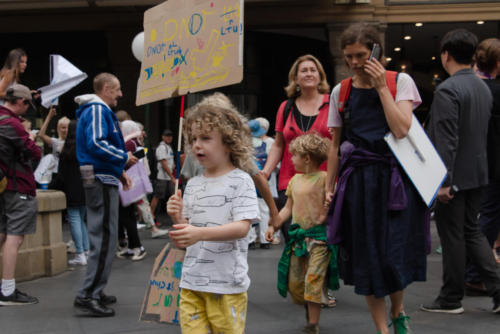 Little girl with climate action banner.