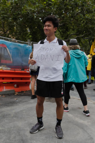 "Young Asian boy with ""Stop Adani"" banner."