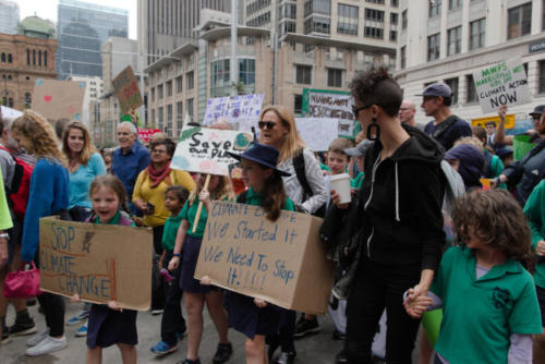 Little girls and parents at climate demo.