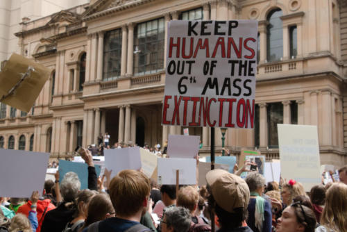 "Banner ""Keep humans out of 6th mass extinction."