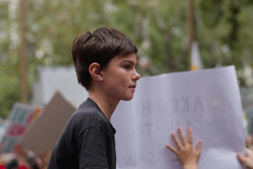 Profile of handsome young boy at Sydney Climate Demo