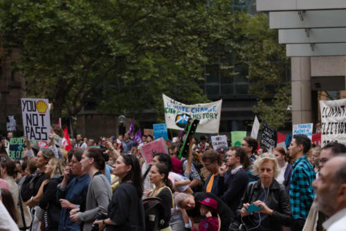 Crowd with banners at Sydney Climate Demo.