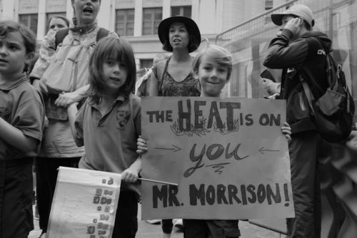 "Little boy at Kids' Climate Demo in Sydney holding a placard ""The Heat is on You Mr. Morrison'. Photograph by Paul Nyssen"