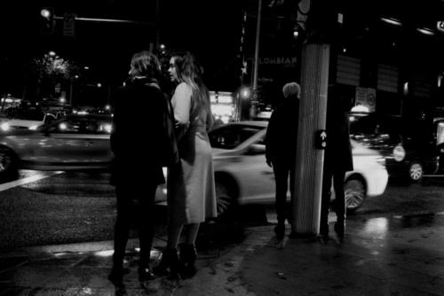 Two Women Trafficlight. Black and white picture of two women on an outing in Oxford street. Sydney.