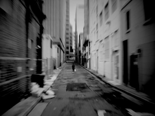 Black and white photograph of woman in back alley in sydney's China town.